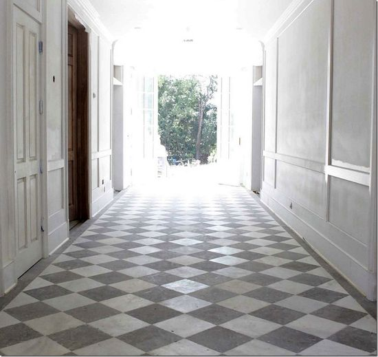 house of windsor foyer: bateig blue limestone and white marble  Glossy trim and wood doors?