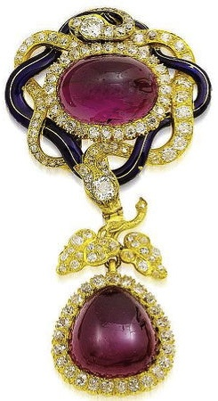 A mid 19th century gold, enamel, garnet and diamond brooch