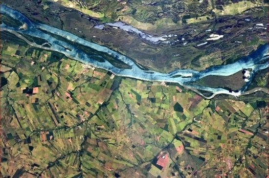 A blue river in Brazilian farmland.  Photo taken by crew aboard the International Space Station.  Chris Hadfield, Twitter