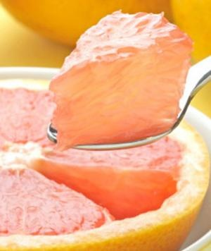 Grapefruit is a key flat-belly food to eat before putting on your bikini!
