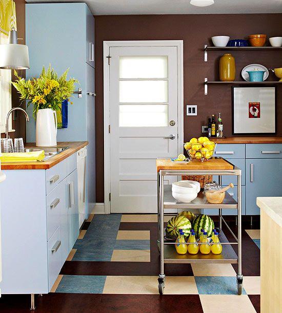 We love this kitchen's cool blue and brown color scheme! Get kitchen storage ideas here: www.bhg.com/...