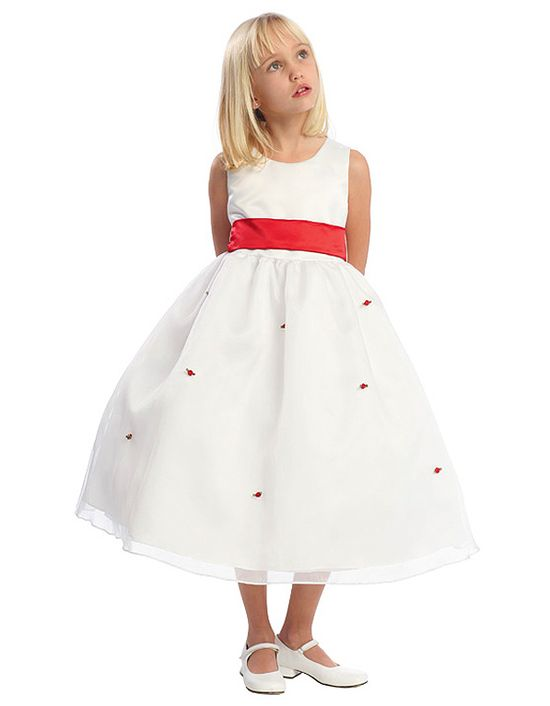 White Flower Girl Dress with Red Sash and Rosettes: This romantic dual colored red and white flower girl dress is and absolute winner for any flower girl destined to be in a wedding ceremony. This dreamy sleeveless scoop neck dress features a white satin bodice with red sash waistband and a organza overlay skirt scattered with petite rosettes. This simple and elegant dress is available in five different colors.