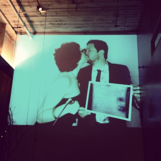 Project your photobooth images on the wall at your reception. Good idea! Anybody got a projector?
