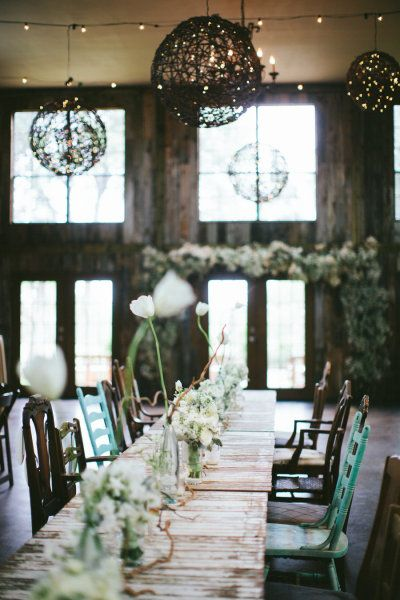 #tablescape mismatched chairs and all white florals