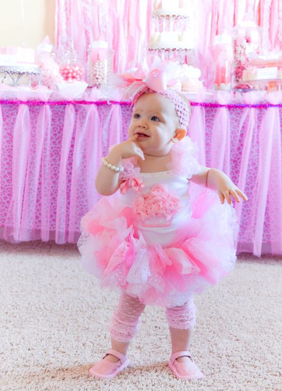 cutest birthday party for a baby girl--complete with tutus, Gigi's cupcakes, and love the huge flower on her head!