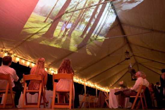 love this idea - projecting a movie or slideshow on the ceiling of a tent! #wedding