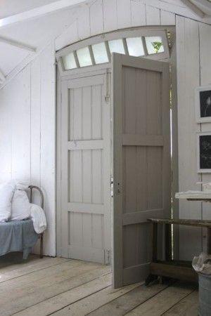 gray door + white walls + light wood floors