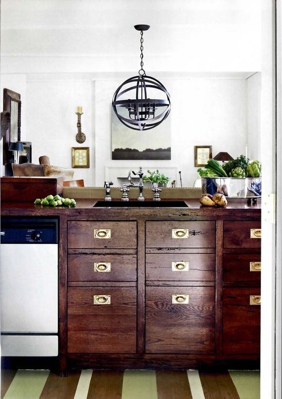 I can't even say how much I love this mix of reclaimed file drawers in the kitchen...