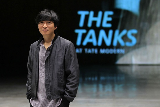LONDON.- South Korean artist Sung Hwan Kim poses for a photograph in the live performance gallery in The Tanks at Tate Modern, London, Monday, July 16, 2012. The Tanks, a new gallery space at the Tate Modern, is the world's first museum space permanently dedicated to exhibiting live art, performance, installation and film works. AP Photo/Sang Tan.