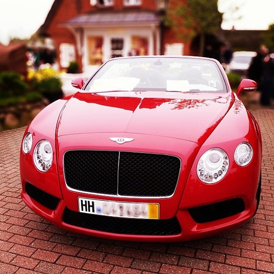 All things bright and beautiful! Stunning Red Bentley!