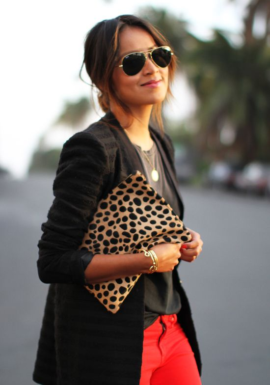 Blazer, red pants and animal print oversized clutch