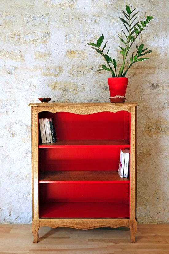 old bookcase with bold painted interior ?