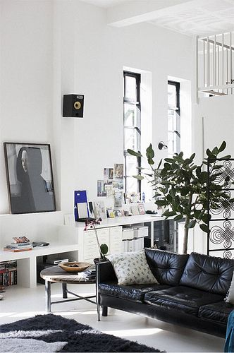 leather black couch x high ceilings :: living room