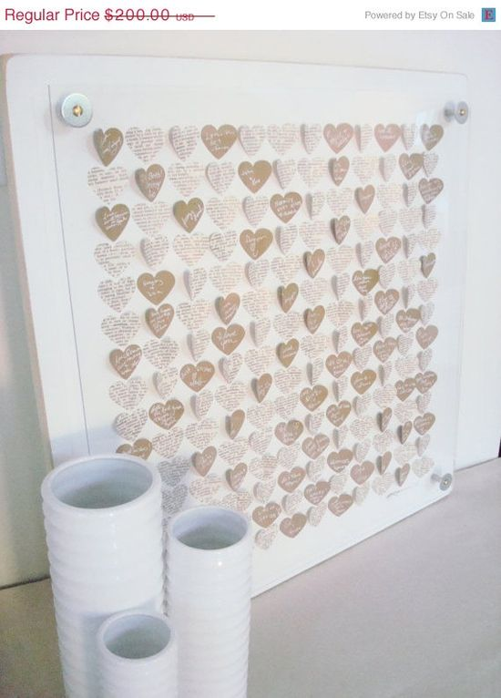 Guest book idea. Have each guest sign a heart then frame after the wedding.