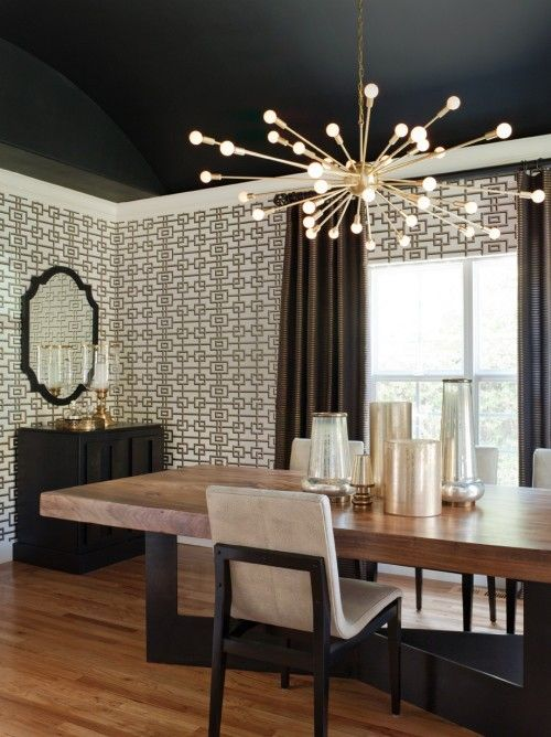 By Lizette Marie Interior Design. This room has mostly white walls, lighter wood floors and a black vaulted ceiling. The black ceiling feels a bit like it just floats up away from you, so you can't readily tell where the ceiling ends. Rather than making the ceiling feel lower, it almost feels like it disappears. It also lets the stunning light fixture stand out like stars agains the night sky.