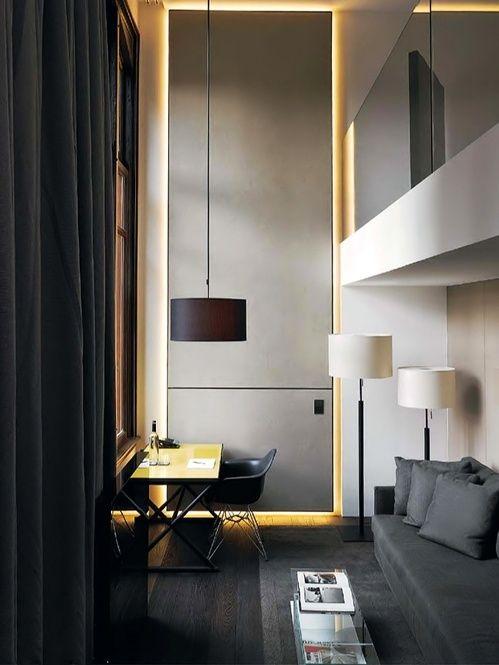 wall cove lighting, Eames molded plastic chairs, black drapes, sofa, flooring