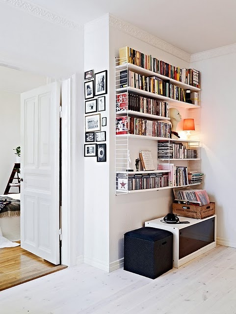 shelves for cds. picture collage. white walls.