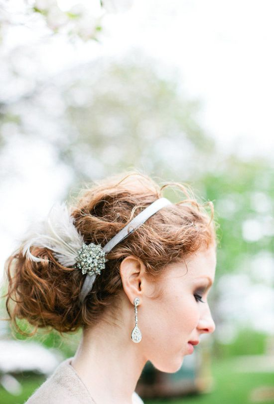 a gorgeous unruly bun and feathered hairpiece by www.fineandfleuri...  Photography by carmensantorelli.com