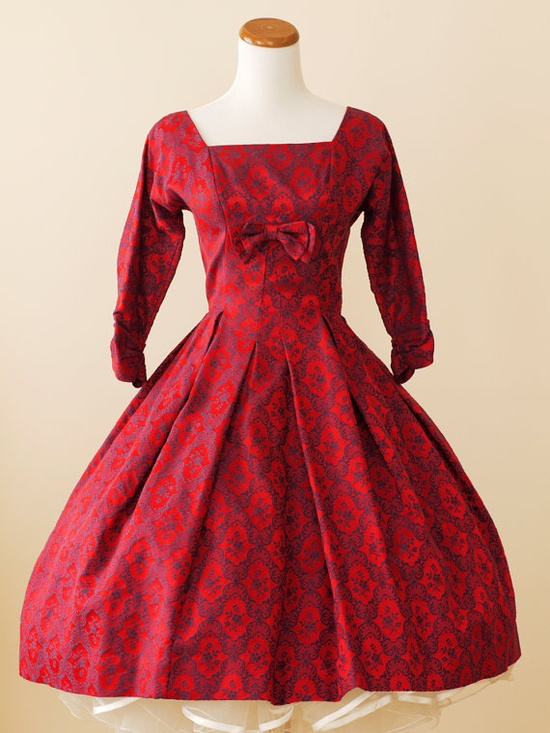 From the exquisite print to the timelessly beautiful tailoring, this amazing 1950s dress is a work of art. #vintage #red #dress #1950s #fashion