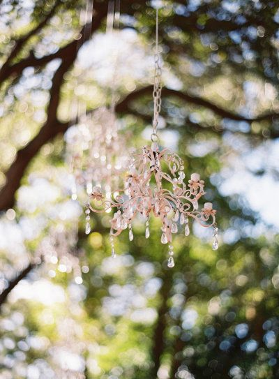 one detail we can't live without? Chandeliers hanging from trees