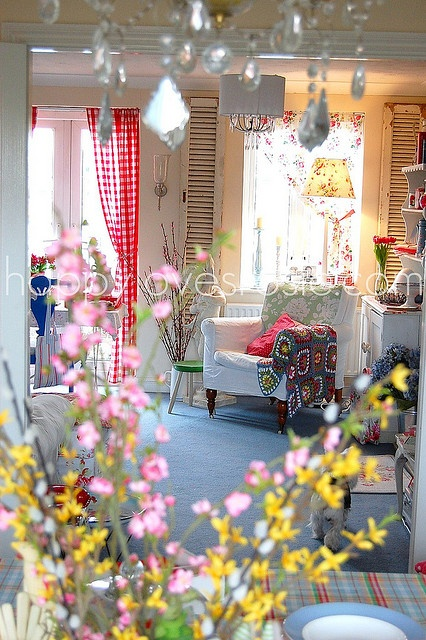 "bright shabby chic; white with red; red check curtains next to floral curtains; I never liked granny-square afghans until i saw how ""Happy Loves Rosie"" layers them into her decor!  So cute and colorful!"