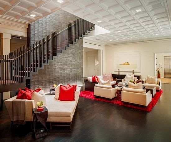 Penthouse Living Room Design with Red Accent