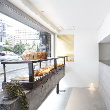 I love this. The use of a great, raw piece of timber and combining it with concrete counter and a polished concrete floor gives the interior a raw, naturalistic feel and adds texture to the neutral space that it all sits within; if anything its creates the aesthetic of a spa, but its use in a bakery in amazing.