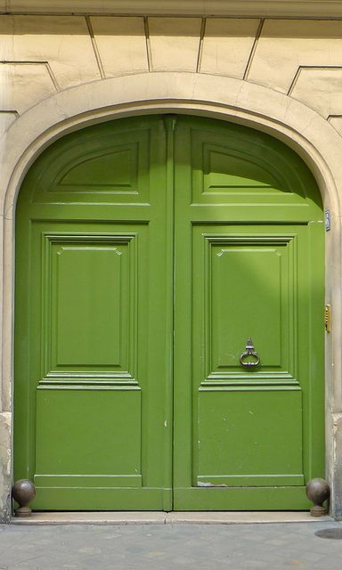 These Parisian doors would look so much more imposing were they not in such a cheerful shade of apple green