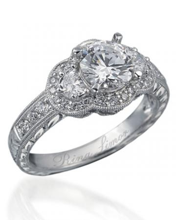 This Rina Limor engagement ring has an antique design and is set in platinum wit