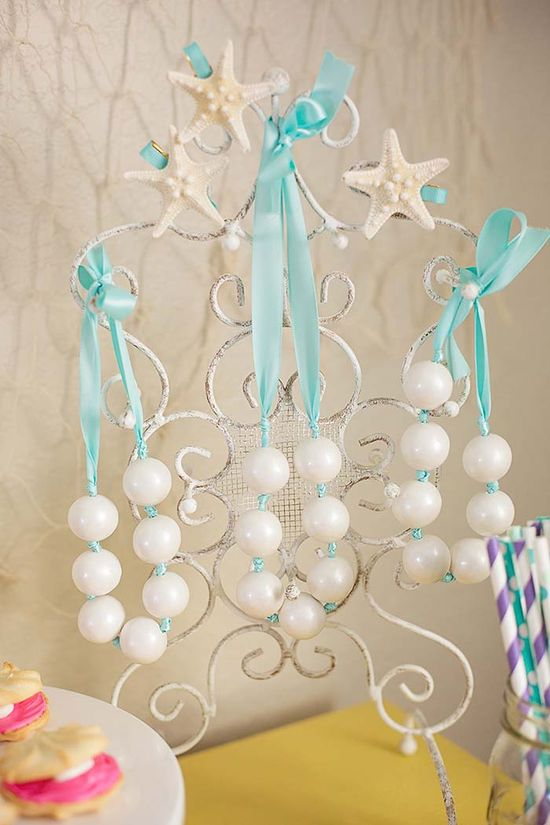 Mermaid necklaces made out of ribbon and white pearl gumballs (available in Kara's Party Shop)! #mermaid #birthday #party #ideas #cake #supplies #decorations #planning #party