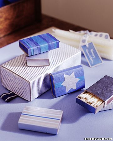 Great Hanukkah gift...pair a bundle of candles with matchboxes that you've wrapped in blue and silver papers.