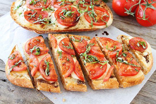 Caprese Garlic Bread on www.twopeasandthe... You NEED this recipe!