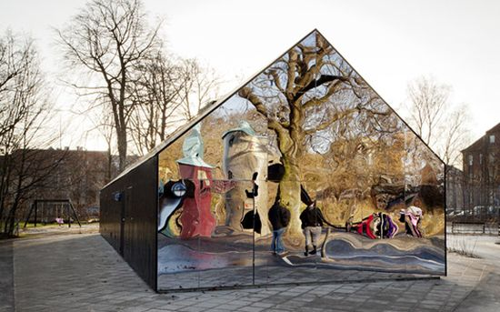 This cool house in Copenhagen has taken an unusual turn, to say the least. Denmark architects MLRP combined an unlikely pair - traditional charred timber boards, not unlike something you'd find cladding a barn or farmhouse, with funhouse mirrors resulting in this interesting home that draws a crowd of architecture aficionados, passersby and kids who frequent this urban playground.
