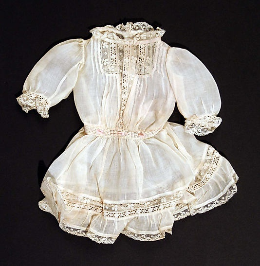 cotton an lace doll's dress dated 1907 ... courtesy of the Metropolitian Museum of Art.