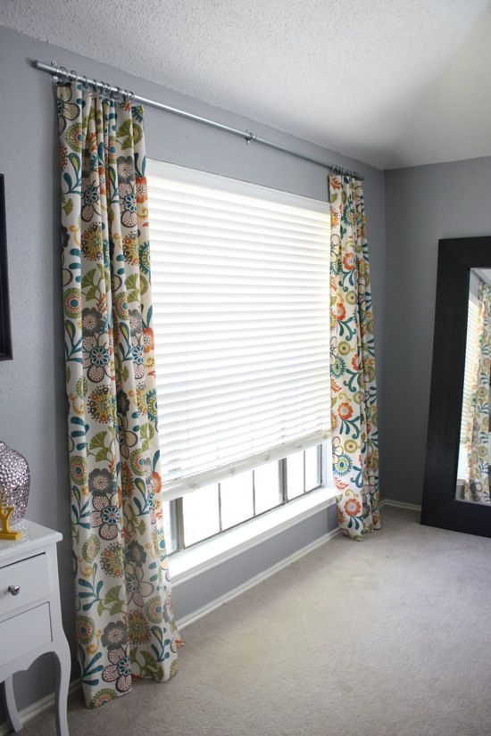 Make A Homemade Curtain Rod From  Electrical Conduit -- yes I think I will need to do this for the 15' wall in the bedroom.
