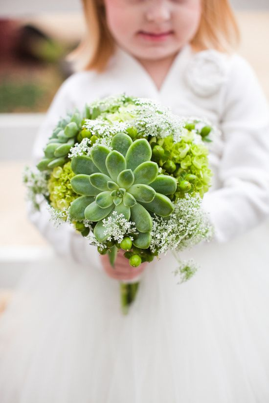 Instead of a traditional bouquet, try a succulent instead. photography by www.ashleybiess.com/