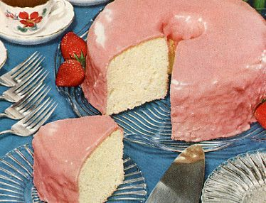 Wonderfully pretty, classic angel food cake dressed in a veil of cheerful pink icing. #angel_food_cake #cake #baking #vintage #food #1950s #cooking #strawberries #party #entertaining