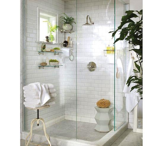 white tiled shower w glass shelves