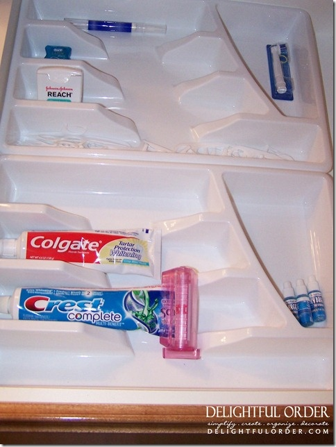Using a utensil organizer for things other than forks, spoons and knifes? genius idea.    Dental hygiene items, lip glosses, chapsticks, the list goes on
