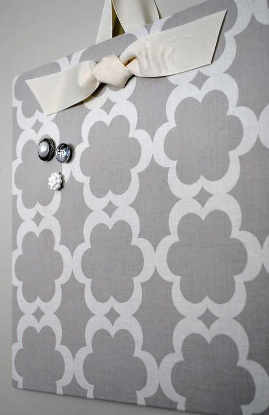 Cookie sheet + fabric = magnetic board. Love this!