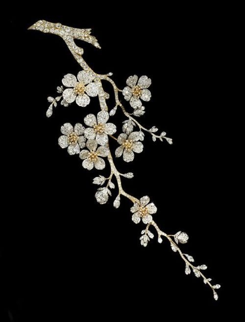 Above: A diamond set corsage ornament in the form of cherry blossom by Vever, 29 cm long. c.1900. Private collection, Photograph courtesy of Sotheby's
