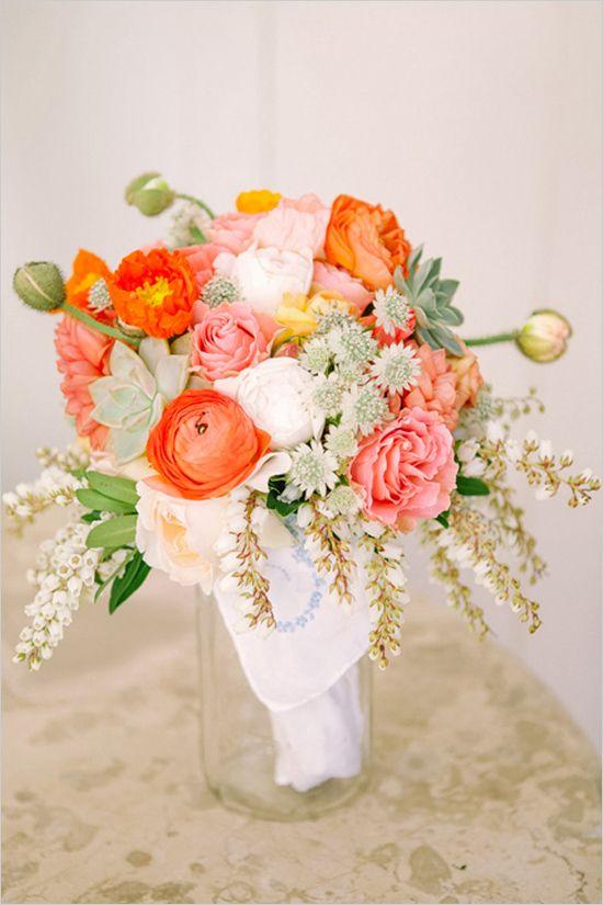 orange and coral wedding bouquet by Spiral Hand