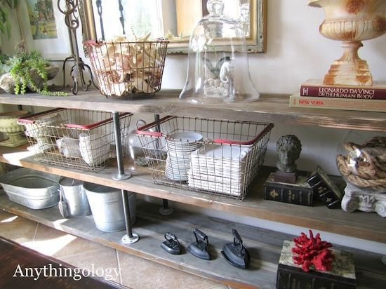very cool plank and pile styled shelves by Anythingology. Love!!