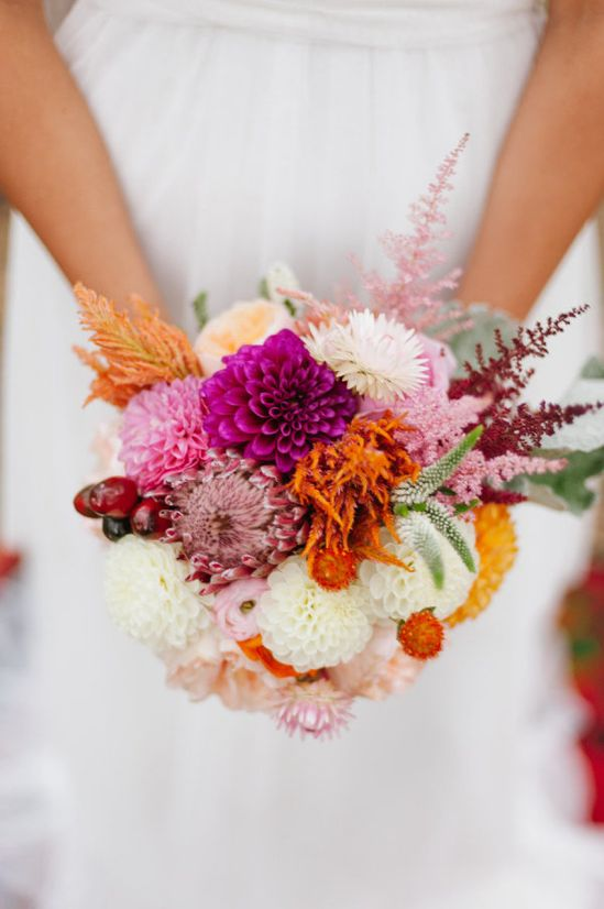 Loving the bright pops of fuchsia in this bouquet. Photography by mattandjulieweddi..., Floral Design by BLUELOTUSGARDENS.COM