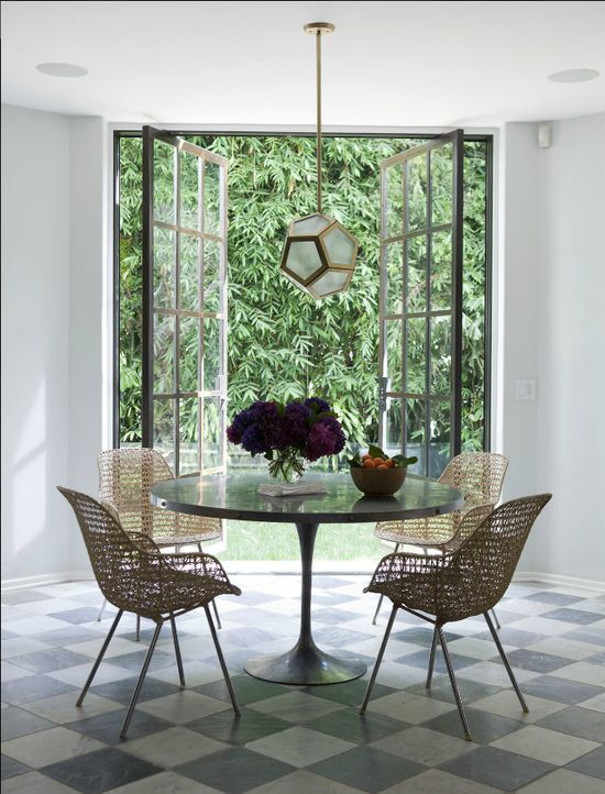 Great casual breakfast nook ~ love the doors, lighting, table & chairs