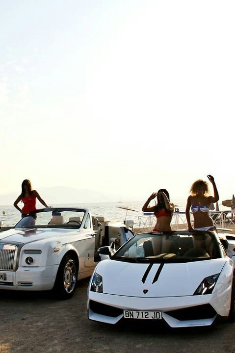 Ride in a sports car on the beach...ignore the girls but i love the cars.
