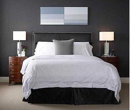 gray black with wood bedside tables. i like seeing natural wood instead of all painted with the gray walls
