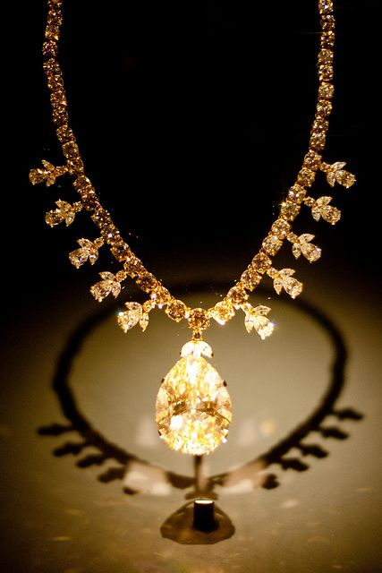 """The Victoria-Transvaal Diamond was cut from a 240-carat rough stone found at the Premier Mine in Transvaal, South Africa, in 1951. The pear shaped, fancy """"champagne-colored"""" diamond was originally cut to 75 carats but then later recut to 67.89 carats for better proportions. Total weight of the 106 diamonds in the necklace is approximately 45 carats. The Victoria-Transvaal diamond was worn in the 1952 movie """"Tarzan's Savage Fury."""""""
