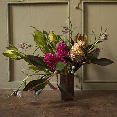 bright fuchsia hyacinth, big leafy greens, a single dusty poppy and winding fritillaria....