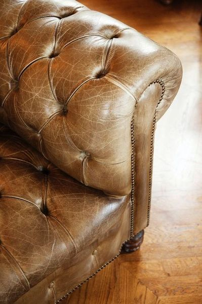 Brown Leather Pin Cushion Couch
